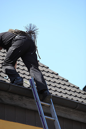 chimney sweep tools used by a professional