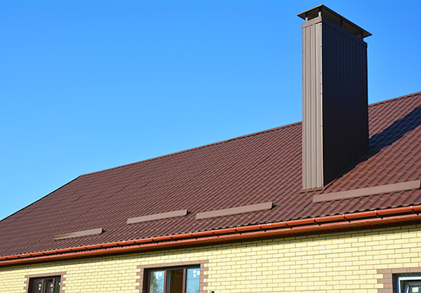 brown metal tiled roof with a tall chimney