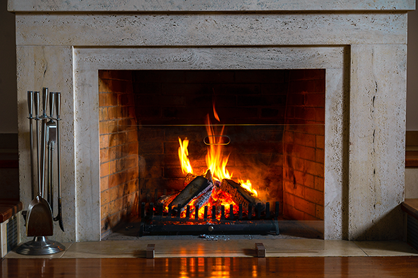 classical wood bruning fireplace