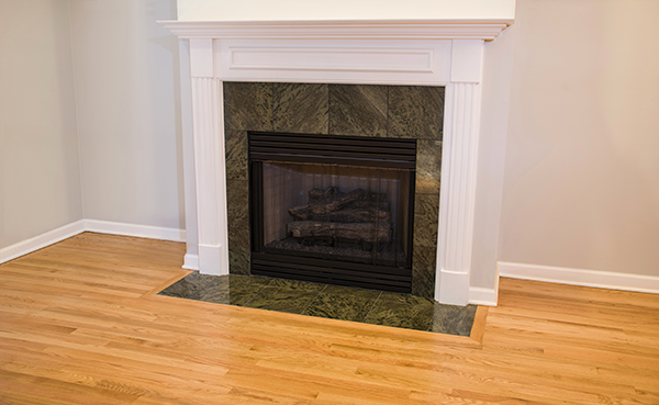 white decorated corner fireplace