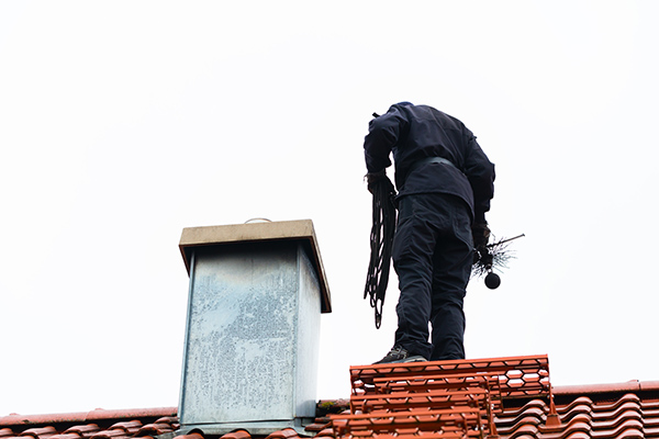 chimney sweeper working on a chimney