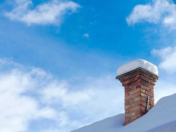 chimney neglect and covered in snow
