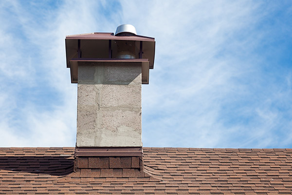 chimney on top of asphalt shingle roof