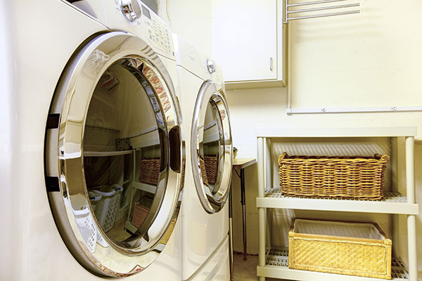 dryer and washing machine inside a laundry room