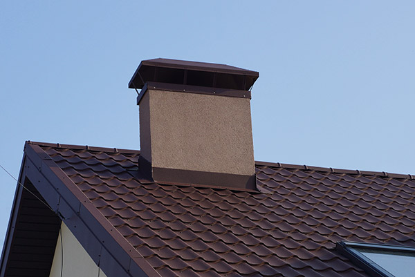metal chimney on a brown tiled roof