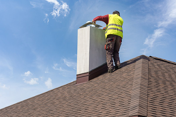 a skilled worker fixing a cracked chimney flue liner
